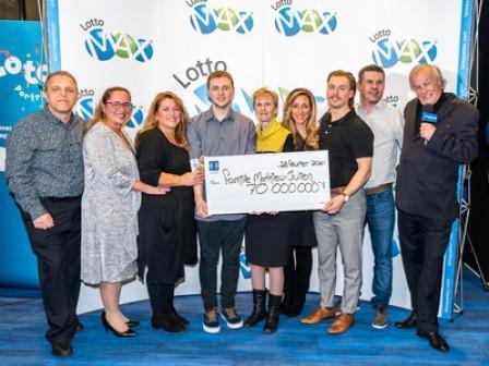 A family of eight share a record jackpot of $70,000,000 at Lotto Max!
